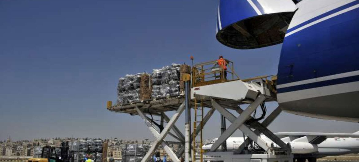 UNHCR humanitarian aid is loaded onto a Boeing 747 at the Marqa International Airport in Jordan before being flown to Erbil in northern Iraq.
