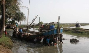 Fishermen manoeuvre a boat in a waterway near Sittwe in Myanmar. People risking their lives to leave Myanmar and cross the Bay of Bengal board boats in locations like this.