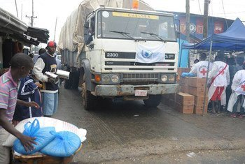 A WFP convoy with needed food supplies entering West Point in Monrovia, Liberia, a community quarantined to prevent the spread of Ebola.