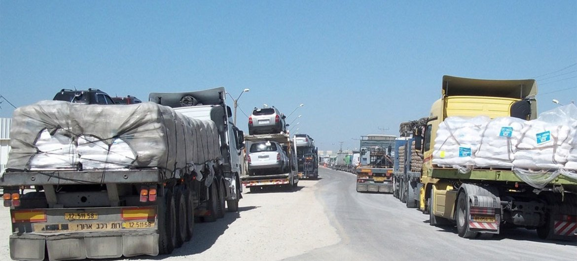 Truckloads of humanitarian aid and commercial goods bottle-necked at Kerem Shalom crossing along the Gaza-Israel border.