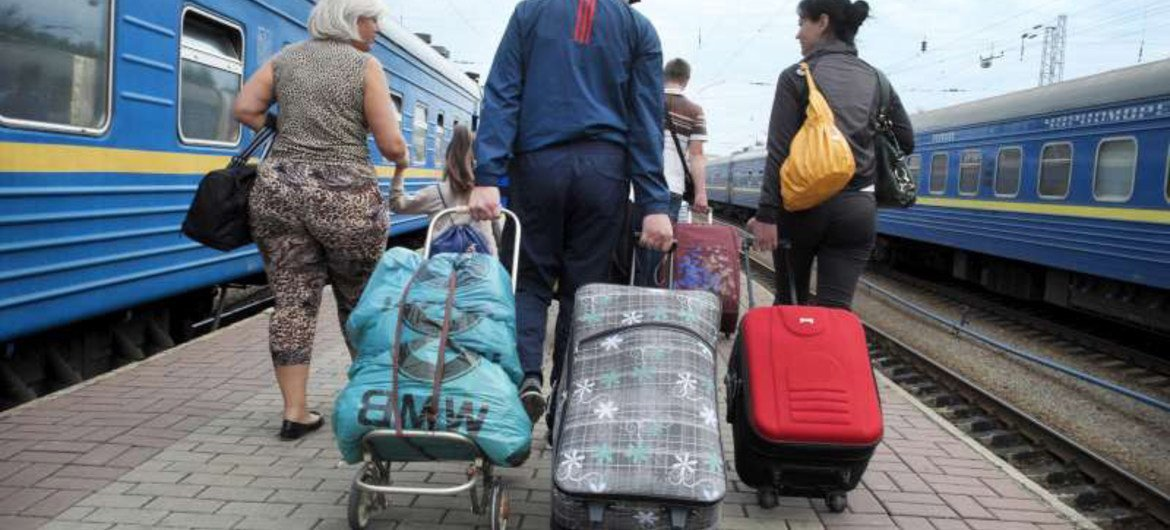 A Ukrainian family with their belongings after arriving at Kyiv by train. They had fled the violence in eastern Ukraine.