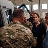 UN High Commissioner for Refugees António Guterres (right) and Special Envoy Angelina Jolie (centre) listening to those involved in rescuing refugees in sea operations in Malta.