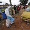 Trabajador de salud en Liberia Foto: OMS/R. Sørensen