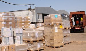 Ebola response: medical supplies, including protective equipment and essential medicine, are loaded onto trucks at the Lungi International Airport in Freetown, capital of Sierra Leone.