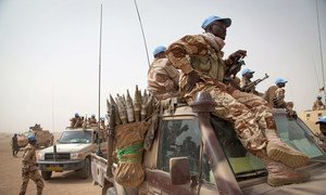 UN peacekeepers from Chad patrol the area outside their base in Tessalit, northern Mali.