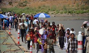 Iraqis fleeing from militants earlier in 2014. The number of Iraqis now seeking refuge in Jordan and Turkey is rising.