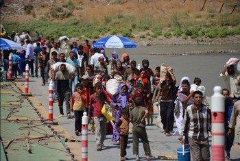 Des Iraquiens fuyant l'avancée de groupes extrémistes armés en Iraq en 2014. Photo HCR/E. Colt