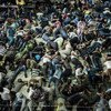 Asylum-seekers and economic migrants take to the seas, waiting out the dangerous journey in the boat's cramped cargo space.