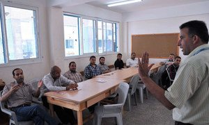 Counsellors from the UNRWA Community Mental Health Programme train a group of teachers in Gaza on how to provide psychosocial support to children and emotional release techniques.