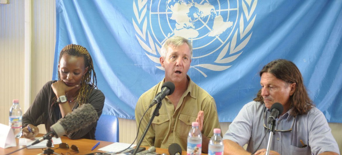 Head of the UN Mission for Ebola Emergency Response (UNMEER) Anthony Banbury (centre) speaks to reporters in Monrovia, Liberia.
