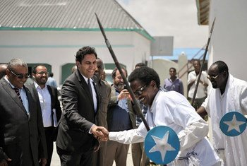 On a visit to Somalia, the Secretary-General's Envoy on Youth, Ahmed Alhendawi (second left), is greeted at the Ministry of Youth by dancers in Mogadishu.