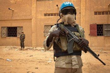 A Senegalese UN peacekeeper patrols along with a Malian soldier in Kidal in July 2013.