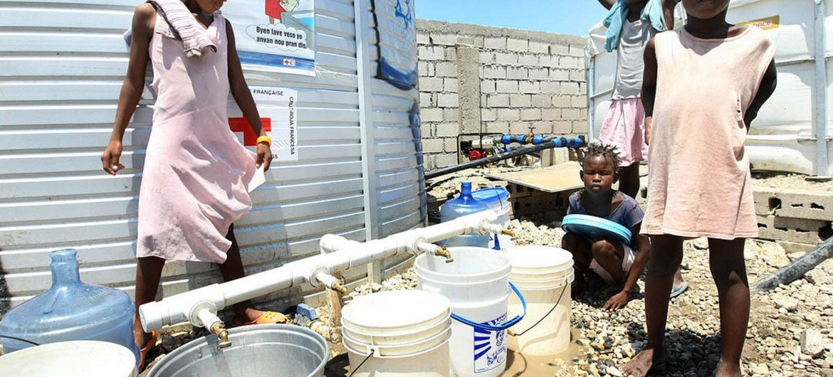 The French Red Cross provides water, sanitation and toilets for 11,000 IDPs at the Centre d'Hebergement Provisoire Automica Dahaitsu in Port-au-Prince, Haiti.