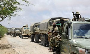 Troops of the Somali National Army and the African Union Mission in Somalia, line up in a convoy on the road leading up to the Al-Shabaab stronghold of Barawe.