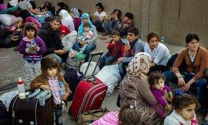 Syrian Kurds from the town of Kobane seeking shelter in Iraq's Kurdistan region.