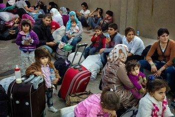 Des Kurdes syriens de la ville de Kobané ayant trouvé refuge dans la région du Kurdistan en Iraq. Photo HCR/D. Nahr