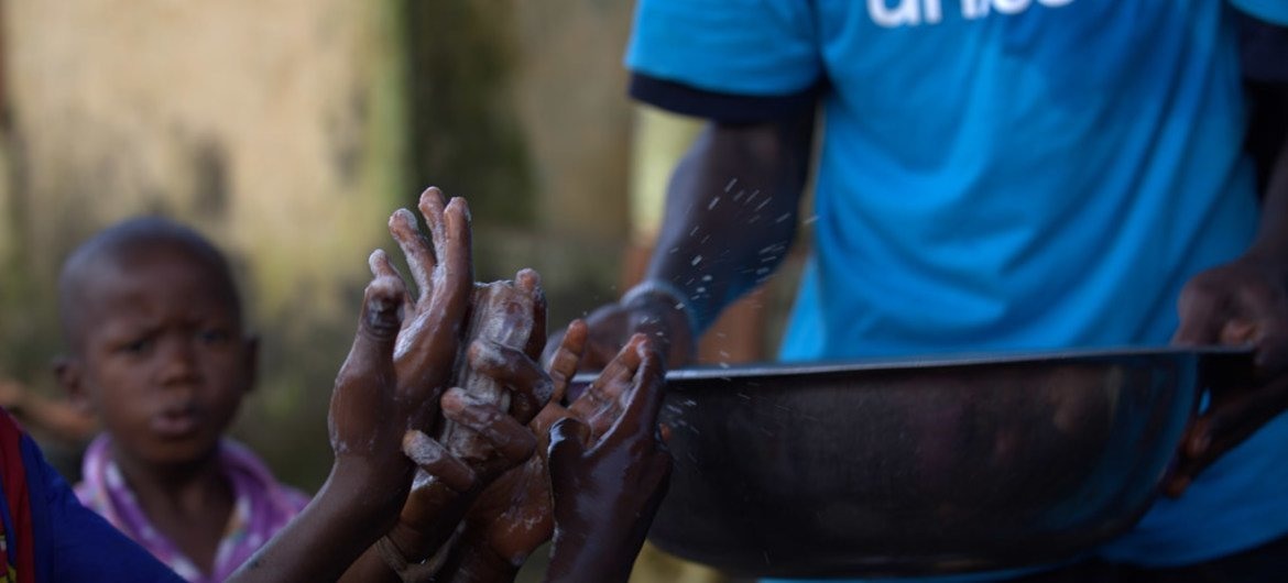 In Conakry, Guinea, a mobilizer teaches children about proper handwashing techniques, which help prevent the spread of diseases, including Ebola.
