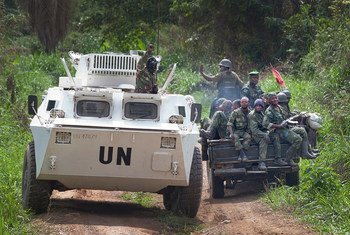A MONUSCO APC is greeted by FARDC soldiers on their way back from the front line in the Beni region of the DRC where the UN is backing the FARDC in an operation against ADF militia.
