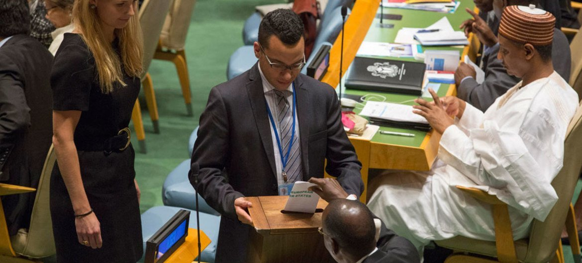 A delegate casts his country's ballot in the election of members for the Human Rights Council.