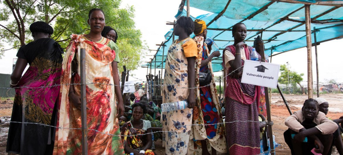 Internally displaced people queue up at a food distribution center in Juba, South Sudan.