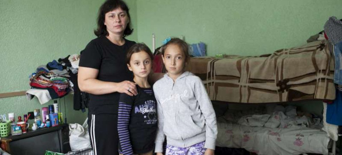A Ukrainian mother with her daughter and young friend in the  room where she lives with her family at a centre for displaced people in Slavyansk.
