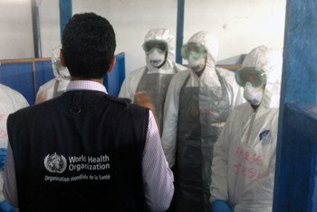 Cuban health care workers receive training at a WHO-supported Ebola Treatment Unit training Centre in Liberia.
