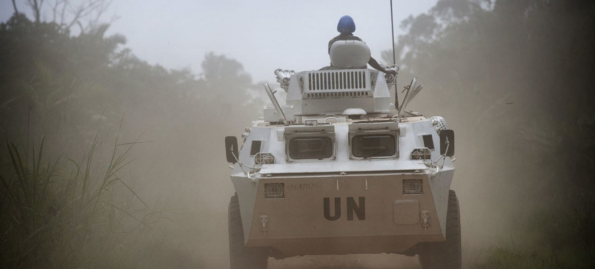 An armored personnel carrier on patrol near Beni, where the UN Organization Stabilization Mission in the Democratic Republic of the Congo (MONUSCO) is supporting the Congolese National Forces (FARDC) in an operation against the Allied Democratic Forces (ADF) rebel militia. March 2014.