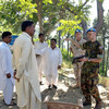 Peacekeepers from the UN Military Observer Group in India and Pakistan (UNMOGIP) speak with the local population near Bhimbar UN Field Station, Pakistan.