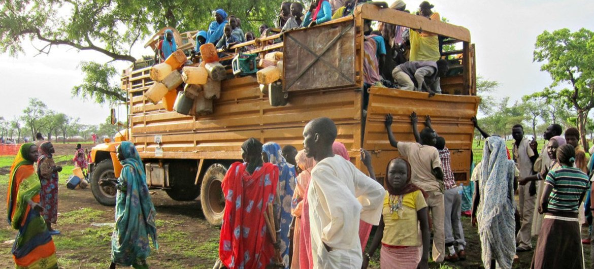 Refugees await unloading at a site in Upper Nile state, South Sudan.
