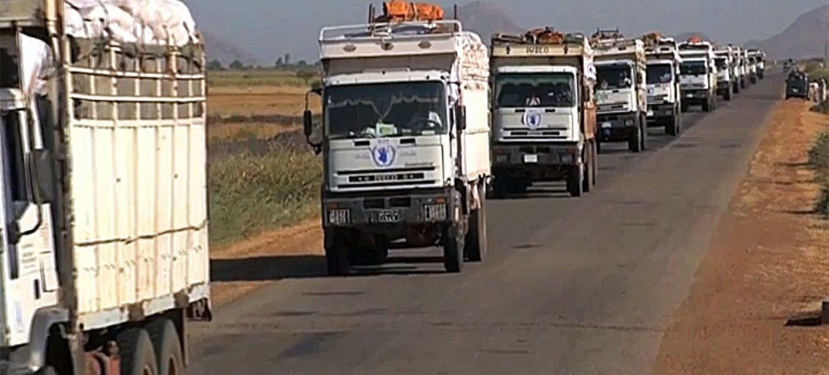 Part of an 18-truck WFP convoy crossing into South Sudan from Sudan, carrying 700 metric tons of food.