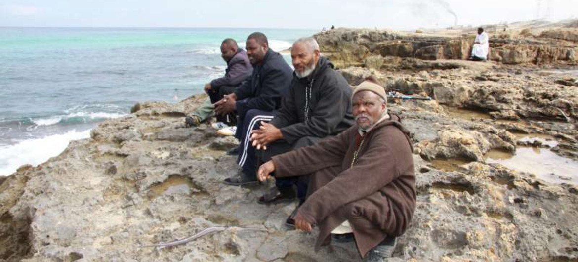 A group of Tawerghan men displaced after the fighting in Libya in 2011. UNHCR is concerned about the situation of some 2,500 Tawerghans who fled their camp in Benghazi in mid-October 2014 to escape fighting.