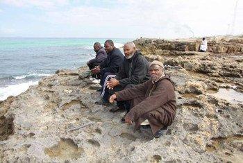 Un groupe d'hommes Tawerghan déplacés après les combats en Libye en 2011.