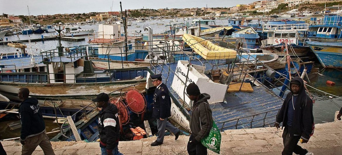 Migrants arriving on Italy's Lampedusa Island after crossing the Mediterranean on a dilapidated boat.