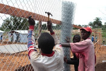 Workers build an enclosure at the Mayagba Ebola community care centre construction site in Bombali District, which is among the areas worst affected by the disease in Sierra Leone.