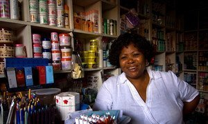 A woman works in a small shop in Ghana.