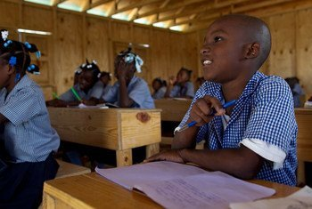 Students inside a newly built classroom at a camp for internally displaced persons in Port-au-Prince, Haiti.
