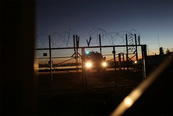An Israeli Security Forces vehicle lights a gate in the security fence that separates farmers in the Biddu enclave from their land in the Seam Zone, which is the land between the 1949 Armistices Line and the West Bank Barrier.