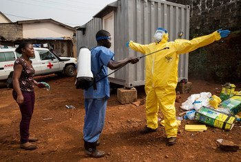 Ambulance depot near an emergency response centre, in Freetown, Sierra Leone. Ambulances and drivers have to be disinfected after each trip carrying suspected Ebola cases.