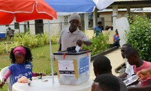 A voter casting his ballot in the senatorial elections in Liberia on 20 December 2014.