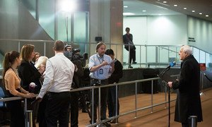 Permanent Observer of the State of Palestine to the UN Riyad Mansour (right) speaks to the press.