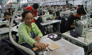 A woman irons fabric at a garments factory at the Sihanoukville Special Economic Zone, Phnom Penh, Cambodia.