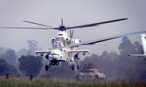 A MONUSCO attack helicopter provides aerial protection for a convoy carrying FDLR ex-combatants from Kanyabayonga transit camp, Democratic Republic of the Congo (DRC).