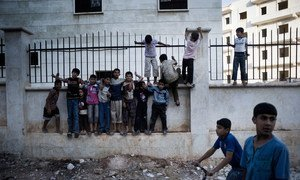 Boys play on the streets of Aleppo, capital of the north-western Aleppo Governorate, Syria.