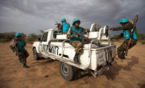 UNAMID troops from Tanzania, deployed in Khor Abeche, South Darfur, conduct a routine patrol in Karbab village.