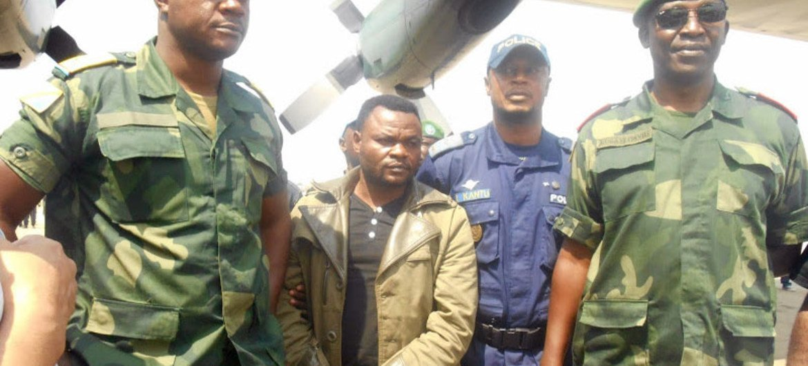 Cobra Matata, leader of the Force de Résistance Patriotique de l'Ituri (FRPI), arrives handcuffed in Kinshasa, Democratic Republic of the Congo on 5 January 2015, after being arrested during a joint operation by UN troops and the Congolese army (FARDC).
