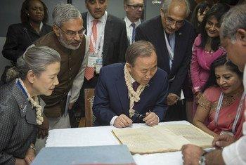 UN Secretary-General Ban Ki-moon (centre), Madame Ban Soon-taek (left) examine Gandhi's original writings during visit to Sbarmati Gandhi Ashram. Gujarat, India. January 2015.