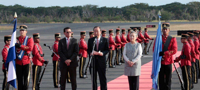 Secretary-General Ban Ki-moon (centre) and his wife, Yoo Soon-taek (right), arrive at the  Monseñor Óscar Arnulfo Romero International Airport, El Salvador.