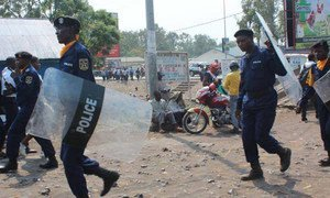 Police officers trying to maintain calm during demonstrations in Kinshasa, capital of the Democratic Republic of the Congo.