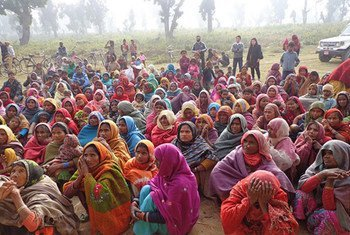 Flood-affected women of the Betani Village Development Committee, in Banke District, Nepal, wait to receive dignity kits.