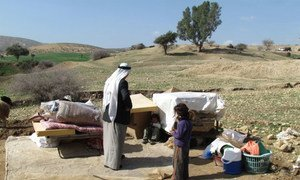 Displaced Palestinians with their belongings, following Israeli authorities demolition of their structures in Ein al Hilwa (Tubas Governorate) in the Jordan Valley on 30 January 2014.